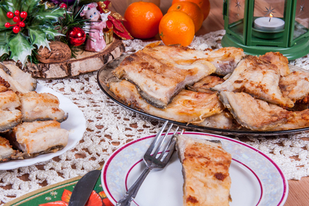 Fried carp -  traditional Polish Christmas Eve dishes on the table Stock Photo