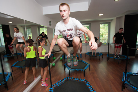 deftness: Otwock, Poland - September 10, 2016:  Fitness. Young people jumping on small trampolines