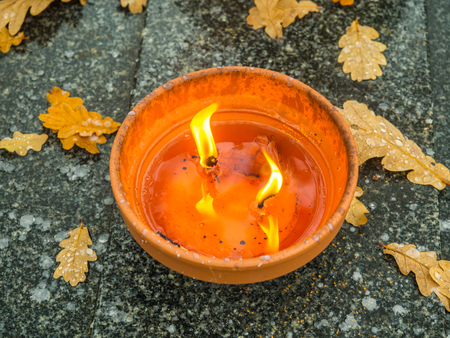 The cemetery torch burns with a bright light Stock Photo