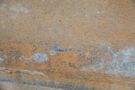 Rusty metal with visible corrosion coating