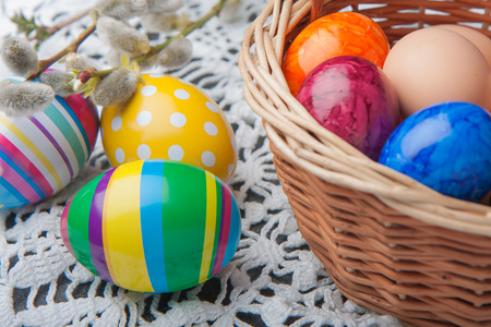 testicle: Coloured eggs and base in Easter basket.