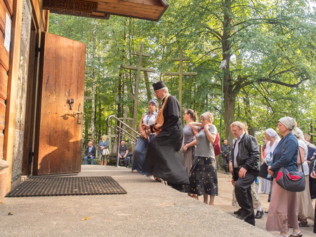 orison: Grabarka, Poland - August 14, 2016: The pilgrims entering  the church on the Holy Mount of Grabarka.