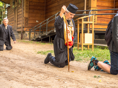 Grabarka, Poland - August 14, 2016: Pilgrims of the Orthodox Church moving on knees around the church  on the Holy Mount of Grabarka. Editorial