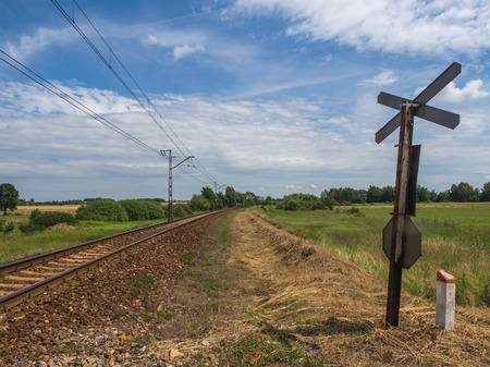 thorium: View over railroad tracks and meadow by a railway crossing