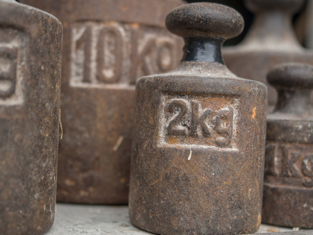 Old, metal weights of different size for a scale Stock Photo