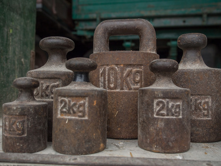 smut: Old, metal weights of different size for a scale Stock Photo
