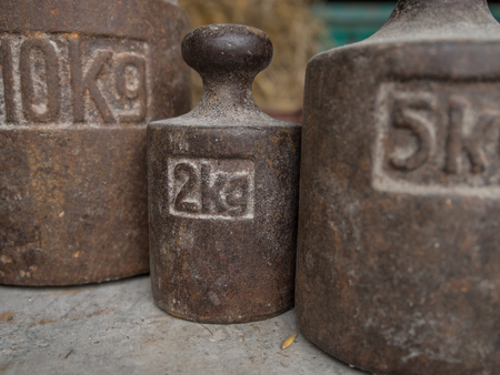 rustiness: Different weights on a  weighing scale Stock Photo
