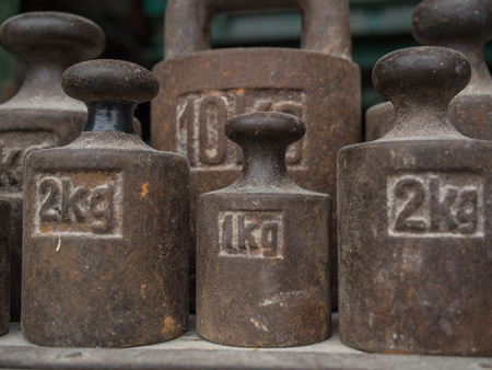 rustiness: Old, metal weights of different size for a scale Stock Photo