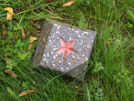 """A Russian red star on a pedestal on a forgotten cemetery of Soviet soldiers in Wolka Weglowa on the """"Bug"""" River"""