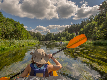 algal: River Wda, Poland - August 24, 2016: Kayakers during canoeing  excursion Stock Photo