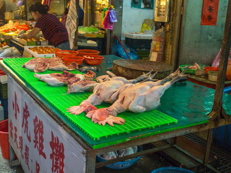 Taipei, Taiwan - October 04, 2016: Hens with heads and feet on a local market  in New Taipei City Editorial