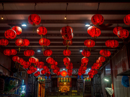 Tamsui, Taiwan - October 03, 2016: Red Chinese lanterns hanging from the ceiling