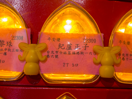Taipei, Taiwan - October 12, 2016: Donors list represented by small lights at the Baoan Temple
