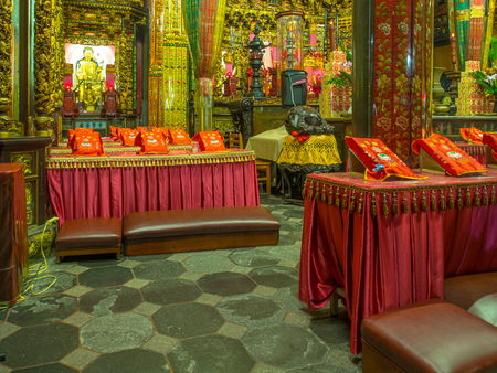Taipei, Taiwan - October 04, 2016: Coloured altars and kneelers in a temple on Taiwan