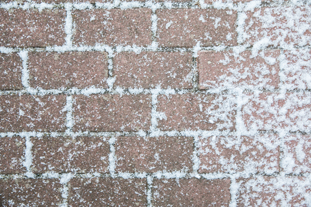 Background, texture. Light brown cube covered with a white coating of snow Stock Photo