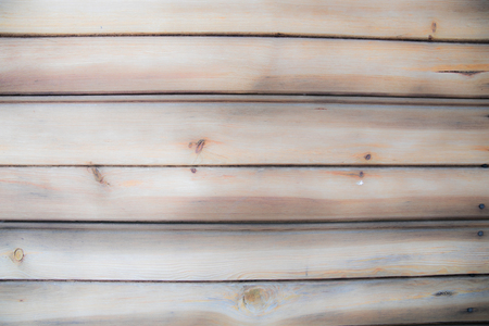 Background, texture. Combined horizontally rustic boards in a dark colour with visible grain.