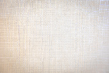 Background, texture. Paper structure covered with many depressions in shades of light brown square