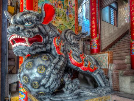 stone lion: Yilan, Taiwan - October 13, 2016: Lion Statue Outside Temple  in Yilan