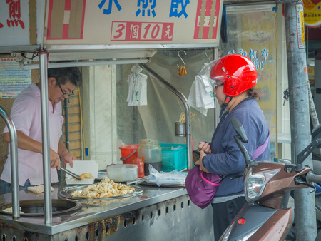 forage fish: Ruifang, Taiwan - October 05, 2016: Typical local bazaar in Taiwan with lots of local products