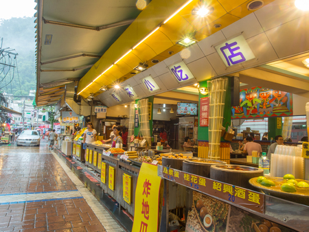 forage fish: Wulai, Taiwan - October 09, 2016: Typical local bazaar in Taiwan with lots of local products