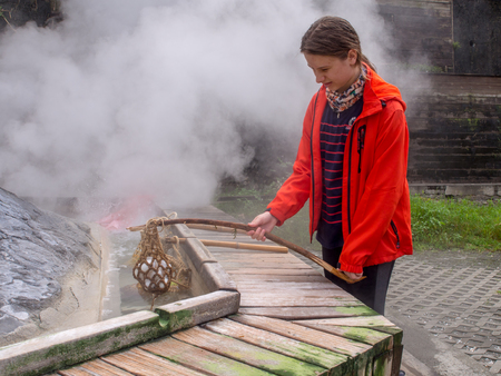 Taiping Mountain, Taiwan - October 15, 2016: Eggs and vegetables being cooked  in  the water of hot springs in Taiwan