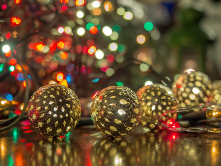 Christmas baubles over dark background with colorful, blurred  lights (bokeh) Stock Photo