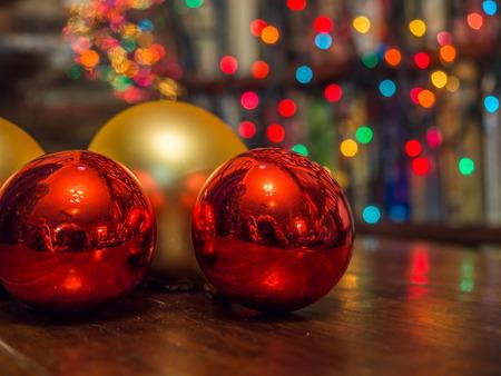 Christmas baubles over dark background with colorful, blurred  lights (bokeh) Reklamní fotografie