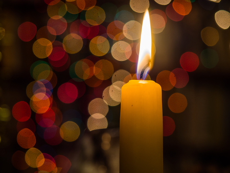Christmas candle  over  the dark background with bokeh