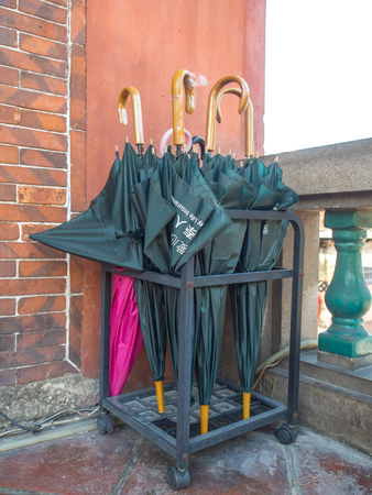 Navy blue umbrellas on a stand in front of a  temple Zdjęcie Seryjne