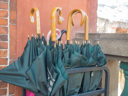 Navy blue umbrellas on a stand in front of a  temple Banque d'images