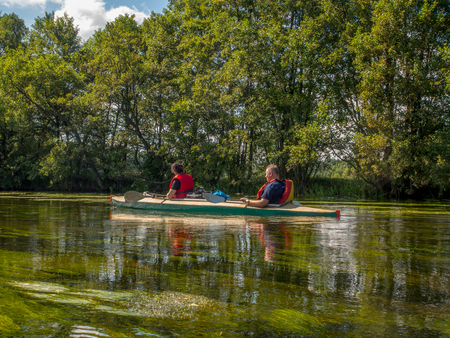 River Wda, Poland - August 24, 2016: Kayakers during canoeing  excursion on the folding kayak