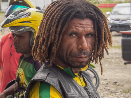 Dekai, Indonesia - January 12, 2015: Portret of the Papuan with a dreadlock