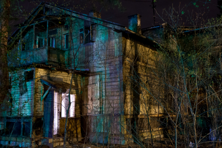 Abandoned wooden house at night in moonlight Stock Photo