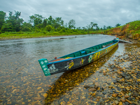 Jungle, Indonesia - January 13, 2015: Colourful boats  on the banks of the Mabul river