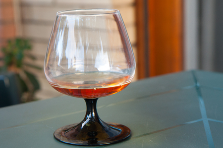 Cognac in the big glass. Stock Photo