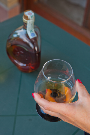 Bottle of cognac and cognac in the big glass.
