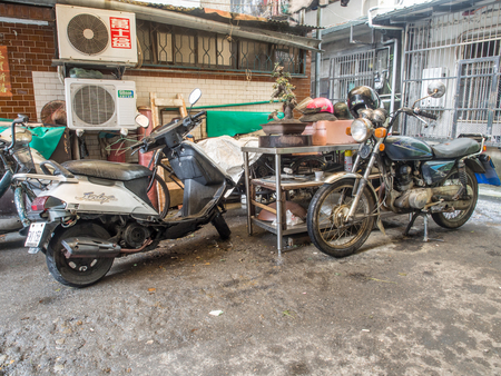 New Taipei City, Taiwan - October 12, 2016: Typical street and backyard between the old building in New Taipei City