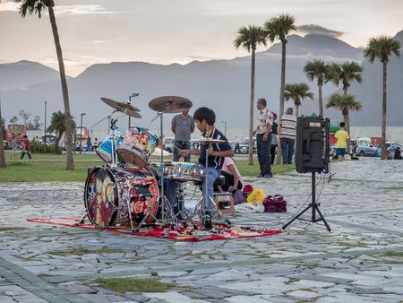 Hualien, Taiwan - October 16, 2016: Boy is playing  percussion near the beach, Chishintan Beach