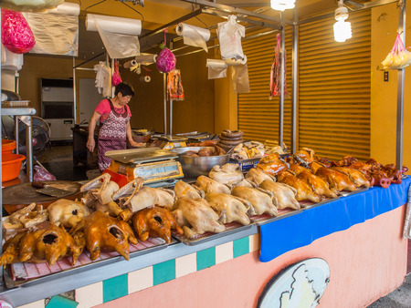 Luodong, Taiwan - October 18, 2016: Typical local bazaar in Taiwan with roasted chicken and pork meat