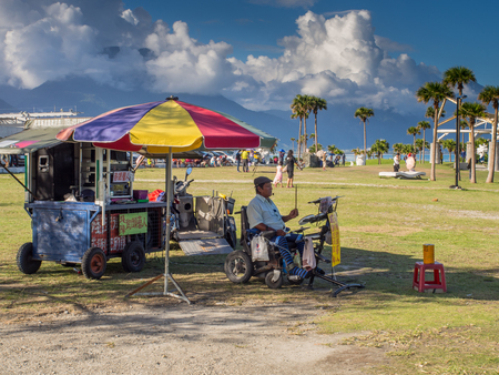 Hualien, Taiwan - October 16, 2016: The man in the wheelchair is playing  percussion near the beach, Chishintan Beach Sajtókép