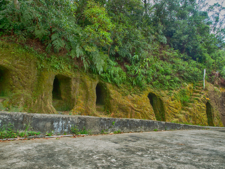 Cave rock covered with moss near a Taiwanese temple in the village of Pingxi. Pingxi is a small town in New Taipei