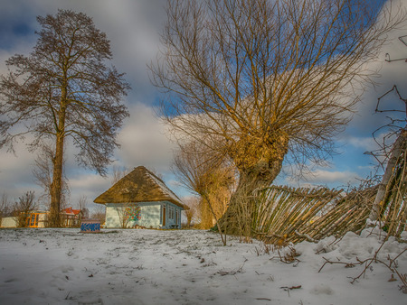 Zalipie, Poland - January  07, 2017: Colourful  log house winter time in the yard of Felicia Curylowa in the village Zalipie in Malopolska Stock Photo