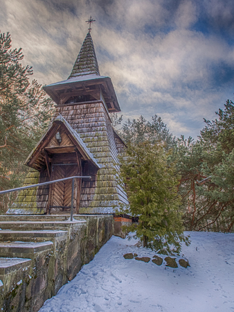 Radachowka, Poland - January 10, 2017: The wooden chapel in Radachowka  at  winter season. This is one of the most picturesque buildings in Mazovia RegionPoland, registered in the Register  of monuments