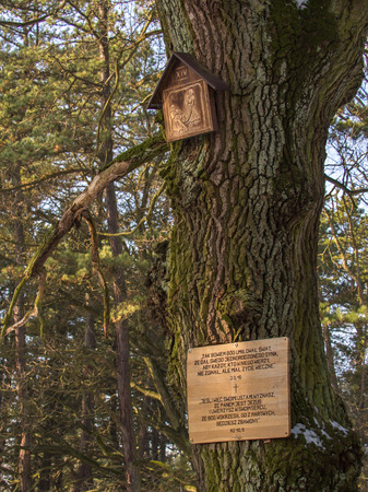"""Fourteenth Station of the """"Cross Road"""" in a small parish in the forest in Jozefow Editorial"""