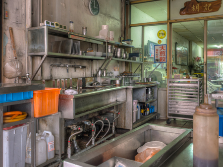 Tainan, Taiwan - October 11, 2016: Kitchen with dishes located on a street outside a building of Taiwanese restaurant . Cooking meals for guests fully visible  both for guests and those passing by. Editorial