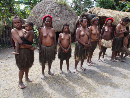 Wamena,  Indonesia - January 23, 2015: Dani tribe Women in their traditional costumes