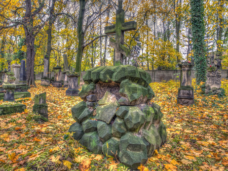 Warsaw, Poland - October 31, 2016: Stone tombs in the Orthodox cemetery in Warsaw, Autumn