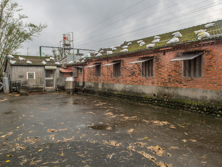 Yilan, Taiwan - October 18, 2016: The roof of the local home protected with sandbags against effects of a typhoon
