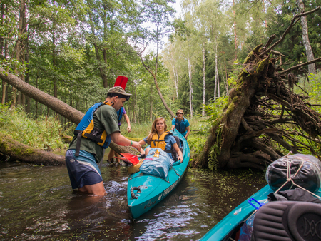 River Dobrzyca, Poland - August 21, 2014: Kayakers during canoeing  excursion Editorial
