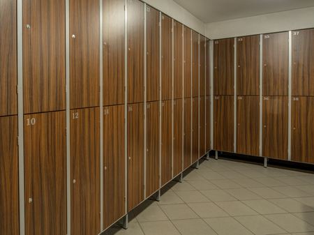 Stock Photo   The Row Of Wooden Cabinets In A Fitness Club Dressing Room